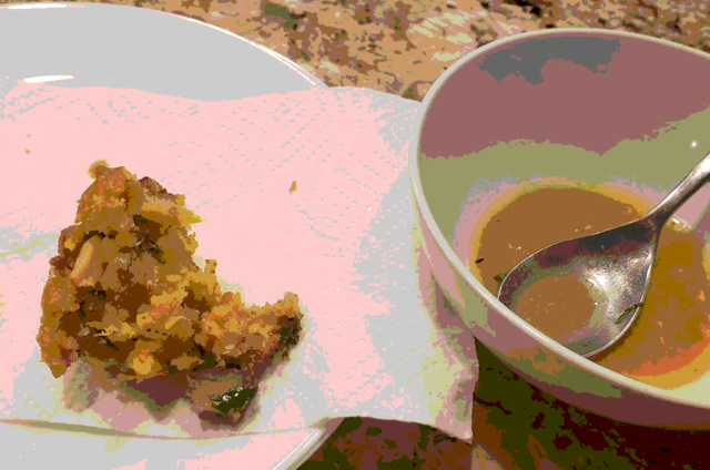 My best mofongo so far, half eaten already. A bowl of chicken broth to the right of it.